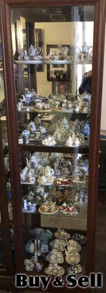 China cabinet with  miniature glass tea sets
