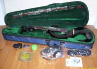 For sale a new full size 4/4 electric violin, c/w a ...