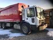 2009 Mack rear load garbage truck. 70/30 split rear ...