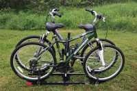 Mens Schwinn Bike, helmet and Thule two bike rack